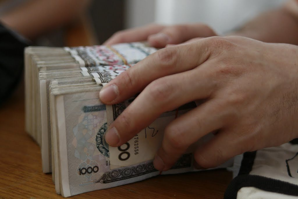 курс сома к доллару